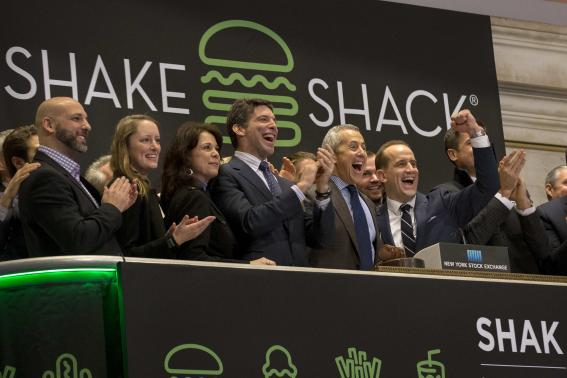Shake Shack founder Danny Meyer and CEO Randy Garutti ring the opening bell at the New York Stock Exchange to celebrate their company's IPO
